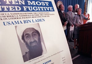 Osama bin Laden: 1999: Osama Bin Laden on a poster at the US Justice Department conference