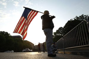 Bin Laden US reaction: A man holds a US flag outside the White House in Washington