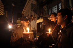 Bin Laden US reaction: People light candles as they celebrate in the streets at Ground Zero