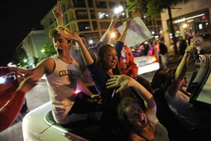 Bin Laden US reaction: Revellers celebrate as they drive near the White House in Washington