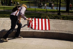 Bin Laden US reaction: A woman looks at the names of victims etched on the memorial