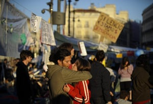 Spain protests: two protesters embrace