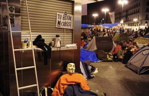 Spain protests: a demonstrator in a Guy Fawkes mask