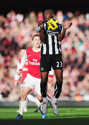 Premier League 2010-11: Newcastle's Shola Ameobi shields the ball from Arsenal's Jack Wilshere