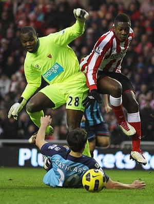 Premier League 2010-11: Asamoah Gyan of Sunderland and Richard Kingson of Blackpool