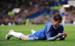 Premier League 2010-11: Chelsea's Fernando Torres looks dejected as he lies on the floor