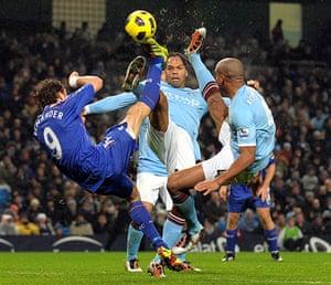 Premier League 2010-11: Bolton's Johan Elmander vies with Manchester City's Lescott & Kompany
