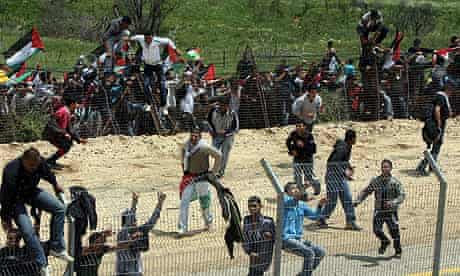 Palestinian protesters cross the Israel-Syria border