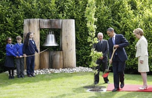obama visits Ireland: Barack Obama plants a tree at the peace bell in Dublin