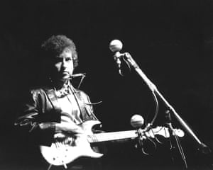 Bob Dylan at 70: Bob Dylan plays an electric guitar for the first time at Newport, 1965