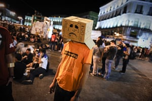 Spain protests continue: Protester attends a demonstration, Puerta del Sol square