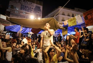 Spain protests continue: Protestors attend a demonstration through the night