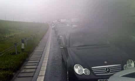 M62 motorway traffic jam in the rain