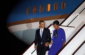 Obama UK visit: Barack Obama and Michelle Obama arrive at London's Stansted Airport