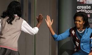 michelle obama high five