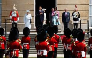 Obama visits UK: Barack and Michelle Obama listen to the US National Anthem