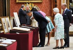 Obama visits UK: Barack and Michelle Obama visit an exhibition, Buckingham Palace