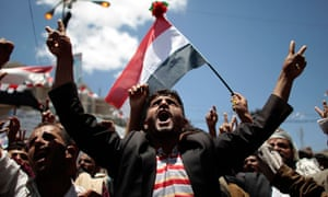 Anti-government protesters shout slogans during a rally in Sana'a