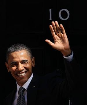 Obama UK visit: Barack Obama waves to the media as he arrives at 10 Downing Street