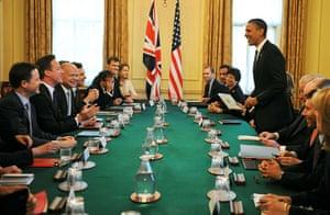 Obama UK visit: Barack Obama takes a seat inteh cabinet room
