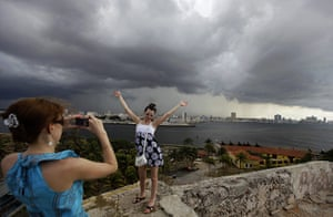 24 hours: Havana, Cuba: A tourist poses for a photograph at the El Morro fort