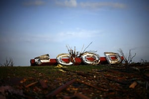 24 hours:  Joplin, Missouri, US: A sign ripped from a market lies on the ground