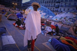 24 hours: Madrid, Spain: A man stands among protesters