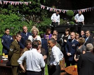 Obama UK visit update: Barack Obama and David Cameron speak with military personel in garden