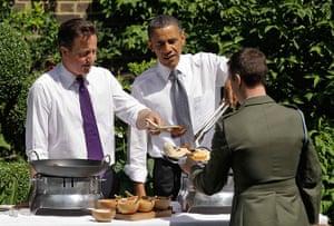 Obama UK visit update: David Cameron and Barack Obama serve food to a member of the military