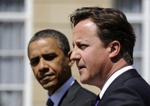 Obama UK visit update: Barack Obama listens as David Cameron speaks during joint press conference