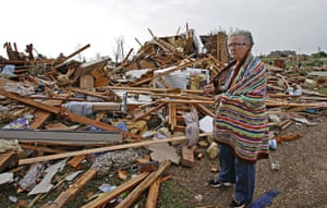 Tornadoes in US: A woman looks at what is left of her home in the Falcon Lake area