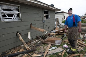 Tornadoes in US: Boards protruding from the side of a house in Joplin