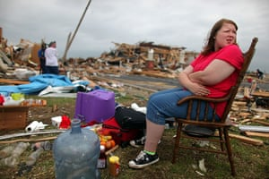 Tornadoes in US: A girl sits outside her family home which was destroyed in Joplin, Missouri