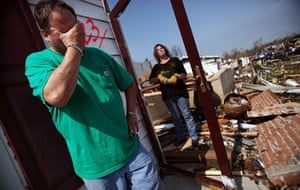 Tornadoes in US: A man pauses while salvaging items after his home was destroyed in Joplin