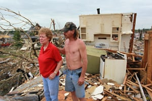 Tornadoes in US: A man stands with his mother in what used to be his apartment in Joplin