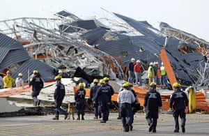 Tornadoes in US: Members of Missouri Task Force One search-and-rescue team work