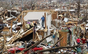 Tornadoes in US: People try to salvage items from a home after it was destroyed in Joplin