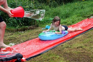 In pictures: expectation: boy whizzing down a water slide