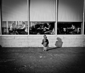 In pictures: expectation: girl looking in restaurant window