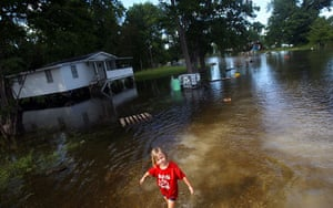 FTA Mario Tama: A girl walks through the floodwaters from the Atchafalaya River Simmesport