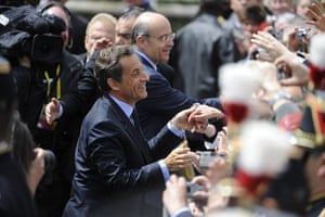 G8 summit: Nicolas Sarkozy and French Foreign Minister Alain Juppe greet the crowd