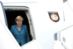 G8 summit: German Chancellor Angela Merkel disembarks from a plane