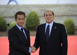 G8 summit: Nicolas Sarkozy shakes hands with Italian Prime Minister Silvio Berlusconi