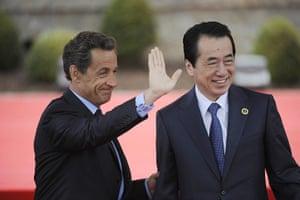 G8 summit: France's President Nicolas Sarkozy waves as he greets Japan's PM Naoto Kan