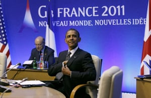 G8 summit: US President Barack Obama looks up at the start of first working session