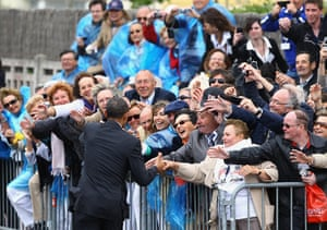 G8 summit: US President Barack Obama shakes hands with local residents