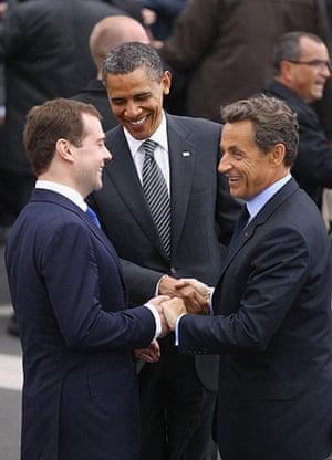 G8 summit: US President Barack Obama, Nicolas Sarkozy and Dmitry Medvedev join hands