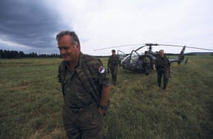 Ratko Mladic: General Ratko Mladic walks away from a helicopter in 1995