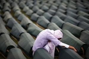 Ratko Mladic: A Muslim woman prays beside the coffin of her relative, a Srebrenica victim