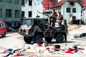 Ratko Mladic: A Bosnian Serb armed vehicle crew drives through Srebrenica in July 1995